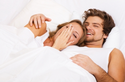 Young beautiful couple relaxing in bed